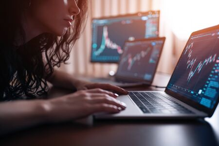 brunette female trade forex or cryptocurrency at home