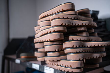 shelf with mold and insoles for shoe on modern factory