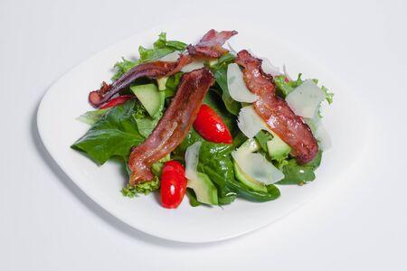 tasty green fresh salad with bacon isolated Stockfoto