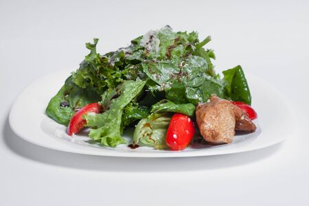 green fresh salad with bacon and tomato isolated