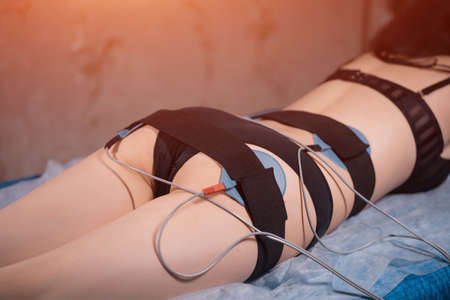 woman at electro stimulation therapy in beauty center