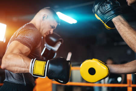 two muscle boxers sport man training and fighting on boxing ring at gym Stock Photo