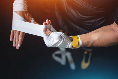 close up of boxer man bandage hand and preparing for training or fighting in gym 版權商用圖片