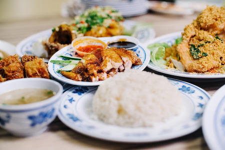 Hainanese chicken rice with other dishes