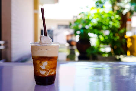 espresso frappe in pet cup with blur background