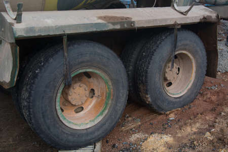 lugs: Large wheel of truck in construction site Stock Photo