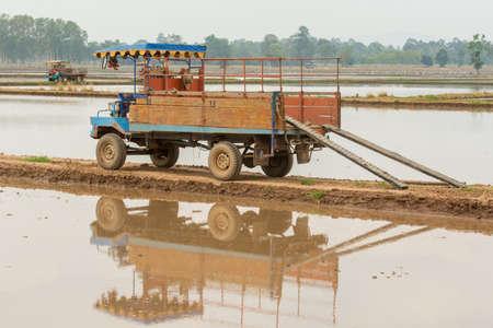 feild: The farm tractor in feild Stock Photo