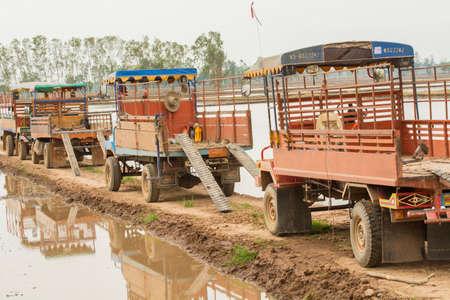 feild: The farm tractor in feild Editorial