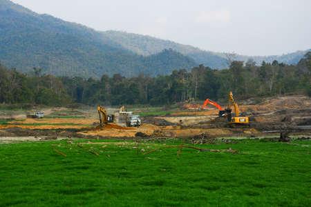 feild: Lamphun, Thailand - Febuary 7 2015 : The machine excavate soil in field Editorial