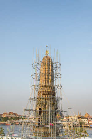 sky scraper: Scaffold surrounds this old pagoda in against a deep blue sky
