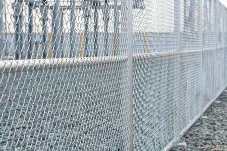enclose: Chain link fence with blur background