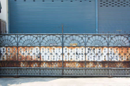 entrance gate: Rusty steel entrance gate closed Stock Photo