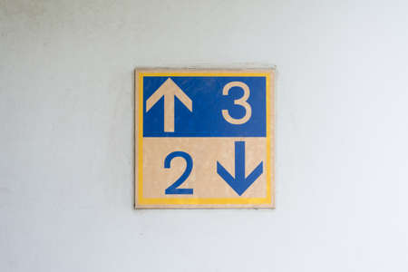 upper floor: Floor signs showing the directions to upper and lower floor