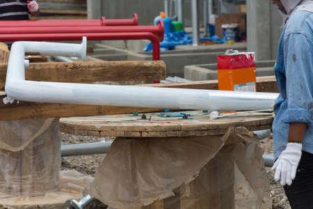 rustproof: Worker Rustproof painting in construction site