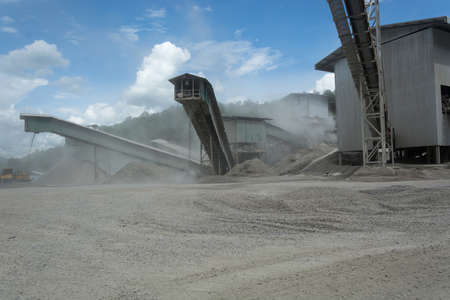 Lorry in quarry plant  with very dusty