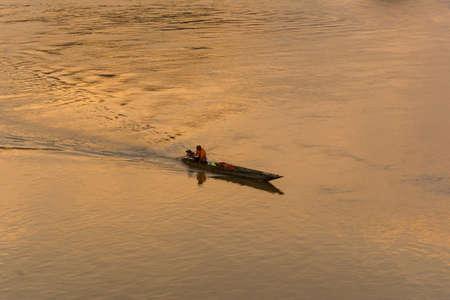 fishermans net: Fisherman has a boat on Mekong river