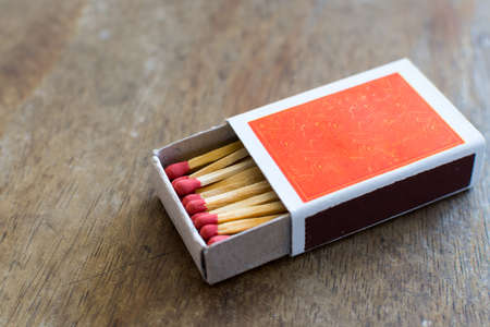 Matches in box with wooden background