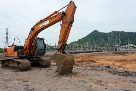 Loader excavator machine doing earthmoving work at construction site