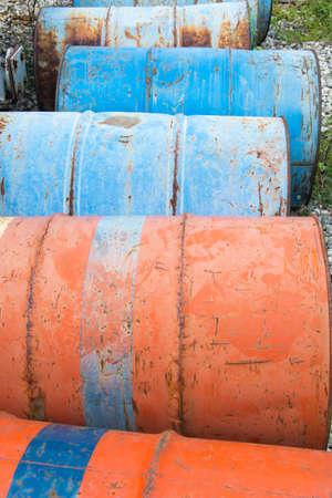 Stack of steel drums on floor Reklamní fotografie