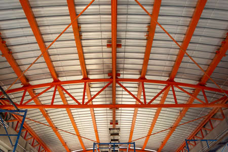 Steel truss structure of building at construction site