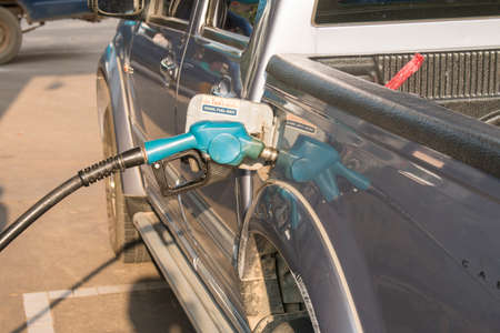 fueled: Passenger car fueled with petrol at petrol station