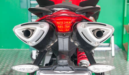 chorme: Detail view of a motorcycle exhausts