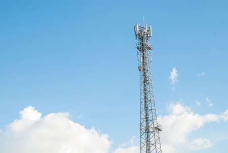 mobile phone communication tower with blue sky background