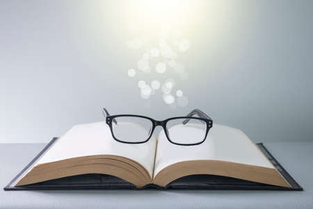 Vintage books and glasses with bright light