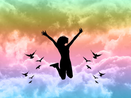 Happy girl jumping on colorful sky,independence concept Banque d'images