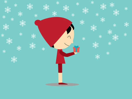 Boy holding gift box with snow flake on green background Stock Photo