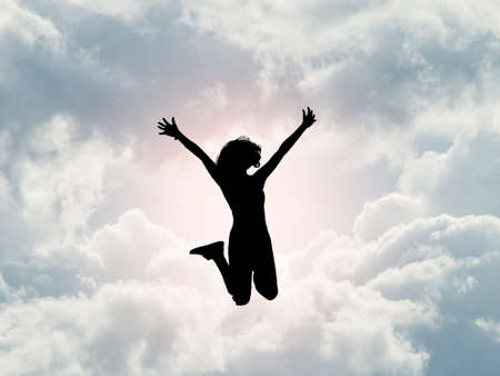 Happy girl jumping on cloud sky,independence concept Archivio Fotografico