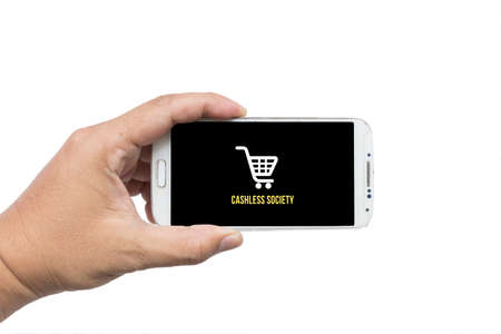Businessman holding smartphone with Cashless society title on white background,Cashless society concept