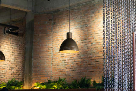 vintage style hanged ceiling lamp warm orange tone light color bulb light Reklamní fotografie