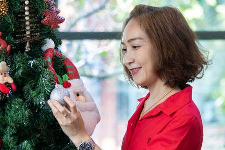 Happy asian woman with chrismas tree Stock Photo