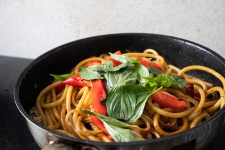 Spaghetti with spicy on pan Archivio Fotografico