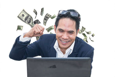 Asian businessman keeping arms raised and expressing positivity on white background,Celebrating success,dollars flying from behind