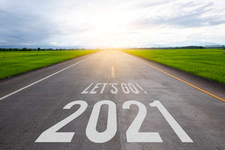 The word let's go written and 2021 on highway road in the middle of empty asphalt road