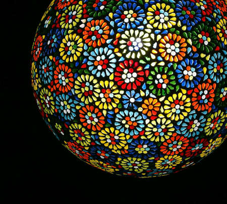ceiling lamp: Ceiling lamp with blooms pattern on black background