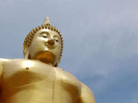 doctrine: Huge gold buddha statue in thai temple, Thailand