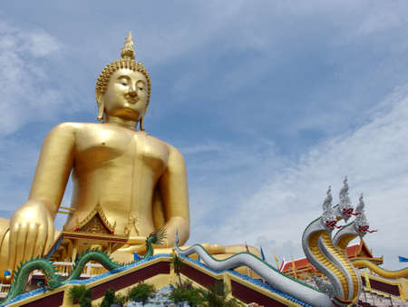 prodigious: Huge gold buddha statue at temple in Thailand Stock Photo