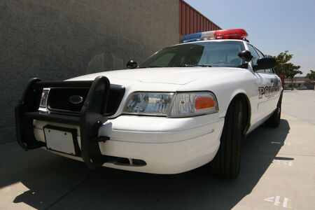 police unit: front of modern patrol car guarding campus