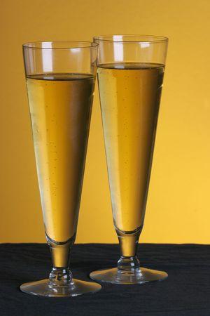 pilsner: two pilsner glasses on a golden backdrop