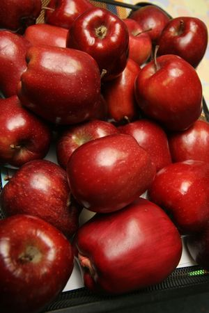 pile of ruby red apples