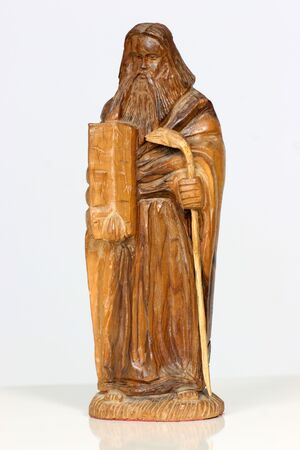 ten commandments: carving from olive wood of Mosses and the ten commandments Stock Photo