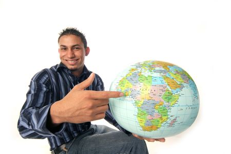chap: chap points out where his adventure awaits on the globe Stock Photo