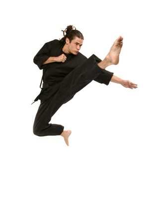 black belt martial artist flies into the air as he kicks and punches in self defense Imagens - 253748