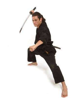aggressive move of a martial artist with katana