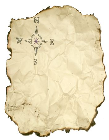 crumpled up paper with burned edges and compass rose Imagens
