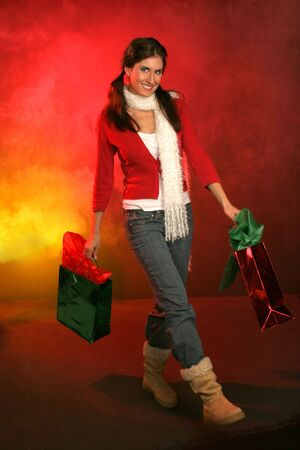 girl walking with holiday bags on red and gold background