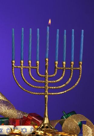 one candle lite on the Hanukkah menorah photo